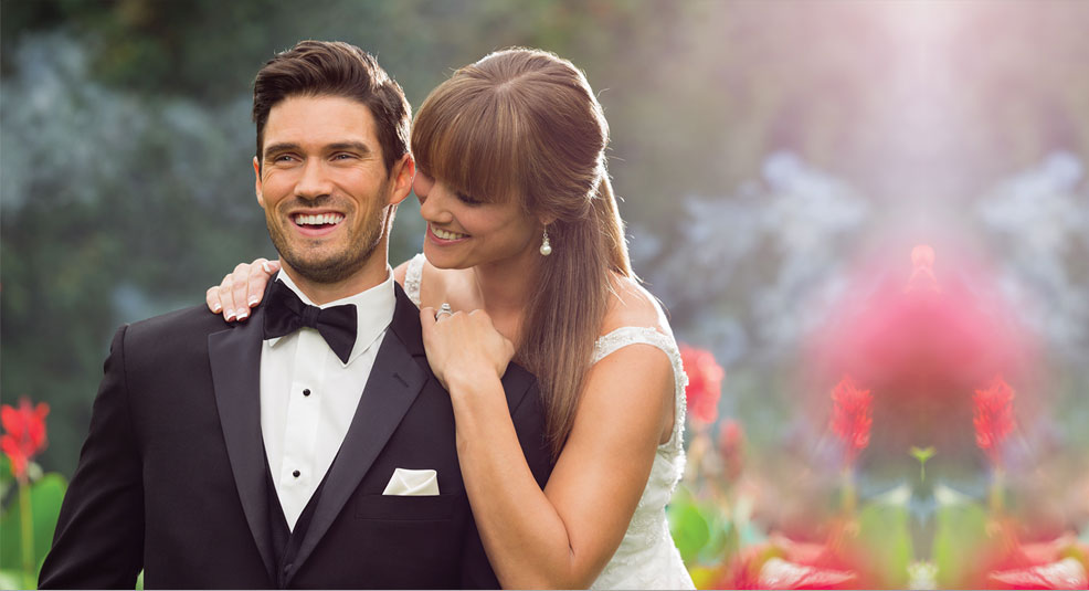 couple dressed in formal-wear embrace